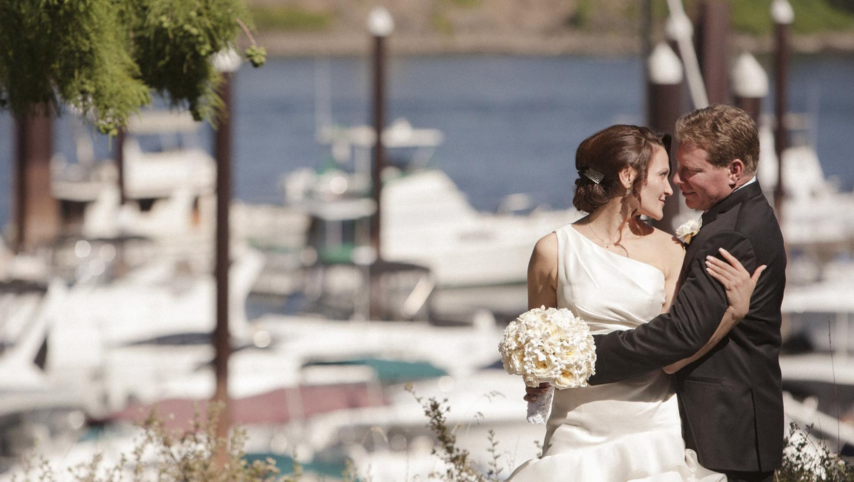 wedding couple embracing on downtown Portland waterfront