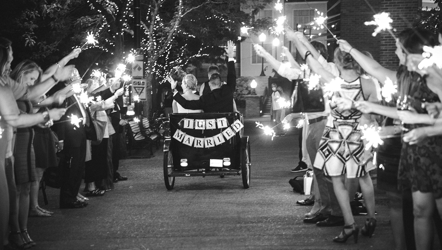 bride and groom riding in pedicab at wedding ceremony at outdoor Portland wedding venue