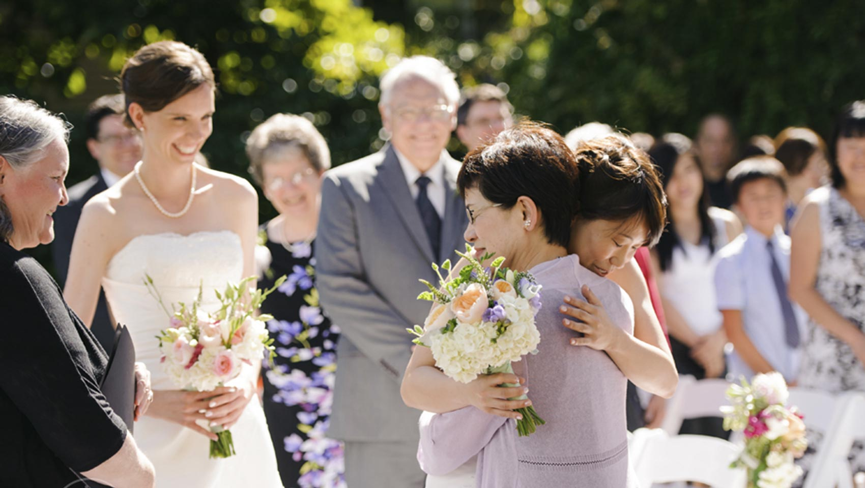 Bride hugs mom at hotel wedding venue