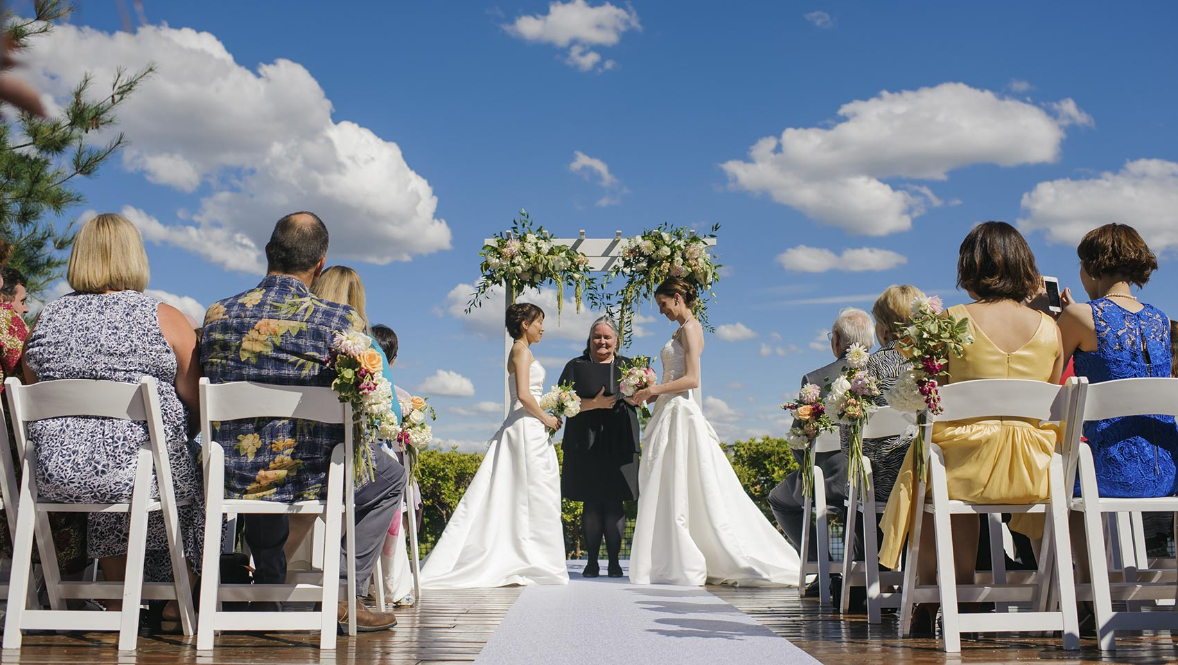 LGBT wedding ceremony at outdoor Portland wedding venue