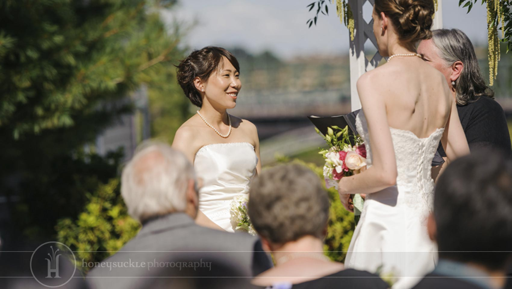 close up of smiling bride at LGBT wedding