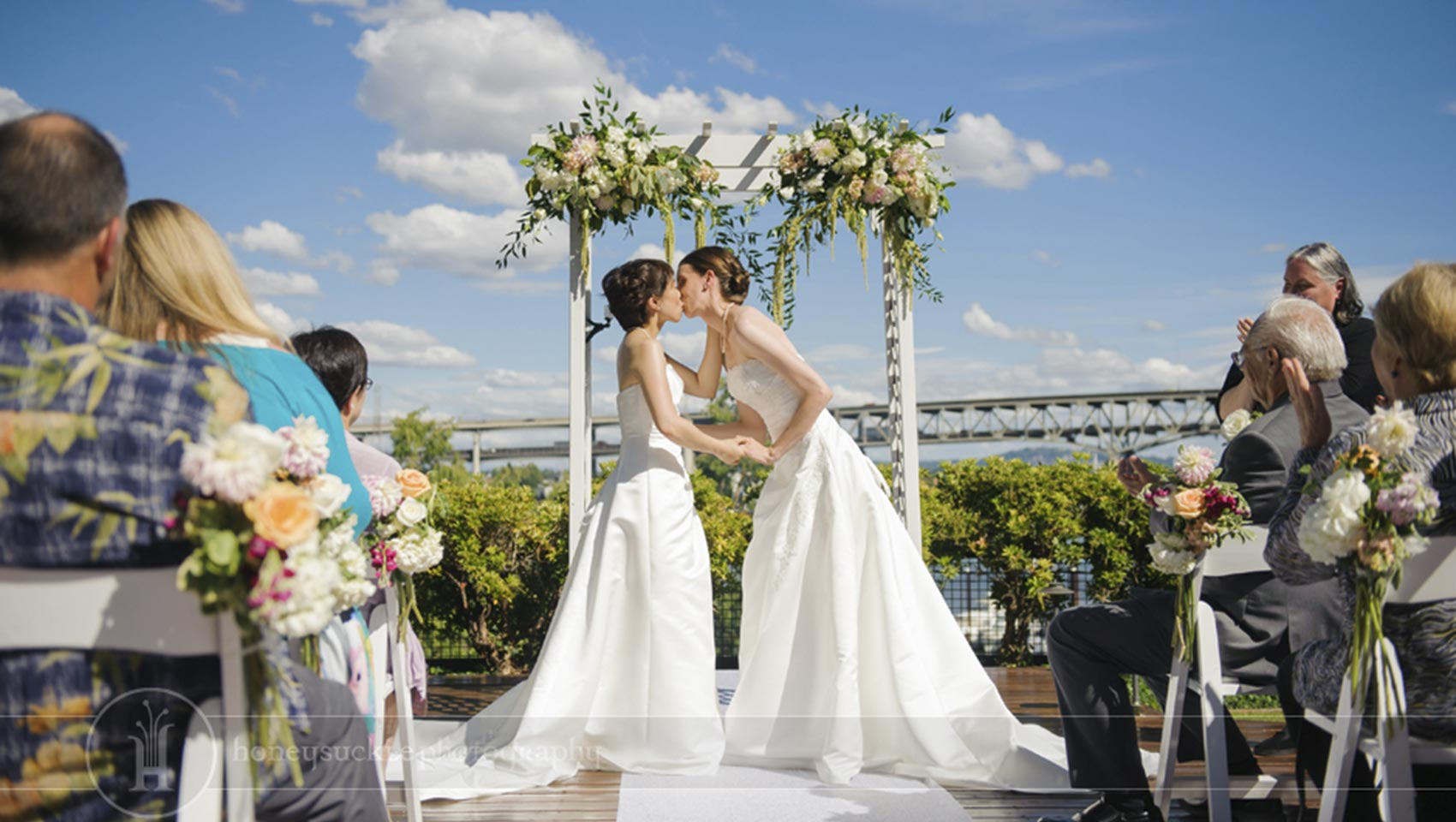 bride kisses bride at LGBT wedding ceremony